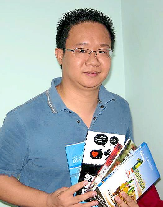 Reading culture: Author and teacher Teo Wei Sing showing the five poem books which he had written that will be available at the book fair.