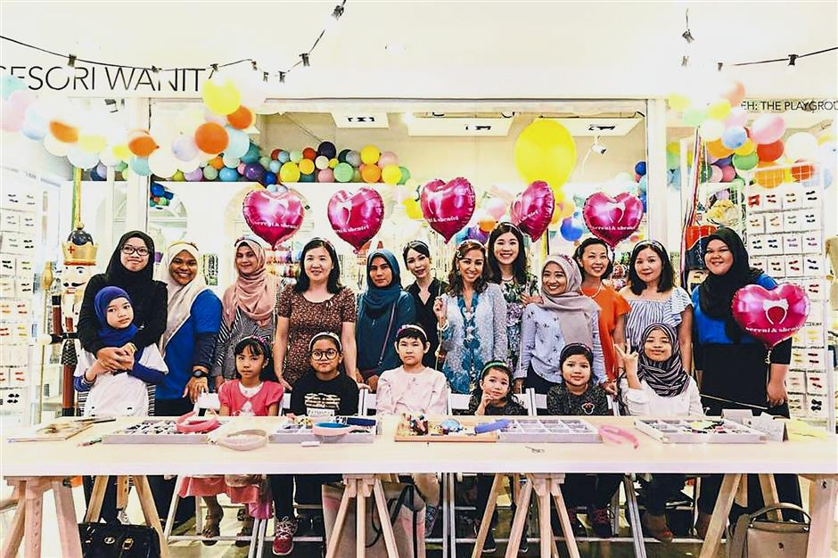 Tengku Zatashah (centre) with the Make-A-Wish children during the launch of the SS x TZ headband collection.