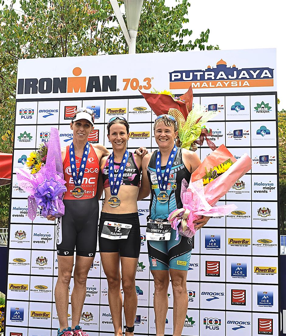 The winners of the professional women category celebrate on the podium (from left) Liz Blatchford, Radka Vodickova and Dimity-Lee Duke.
