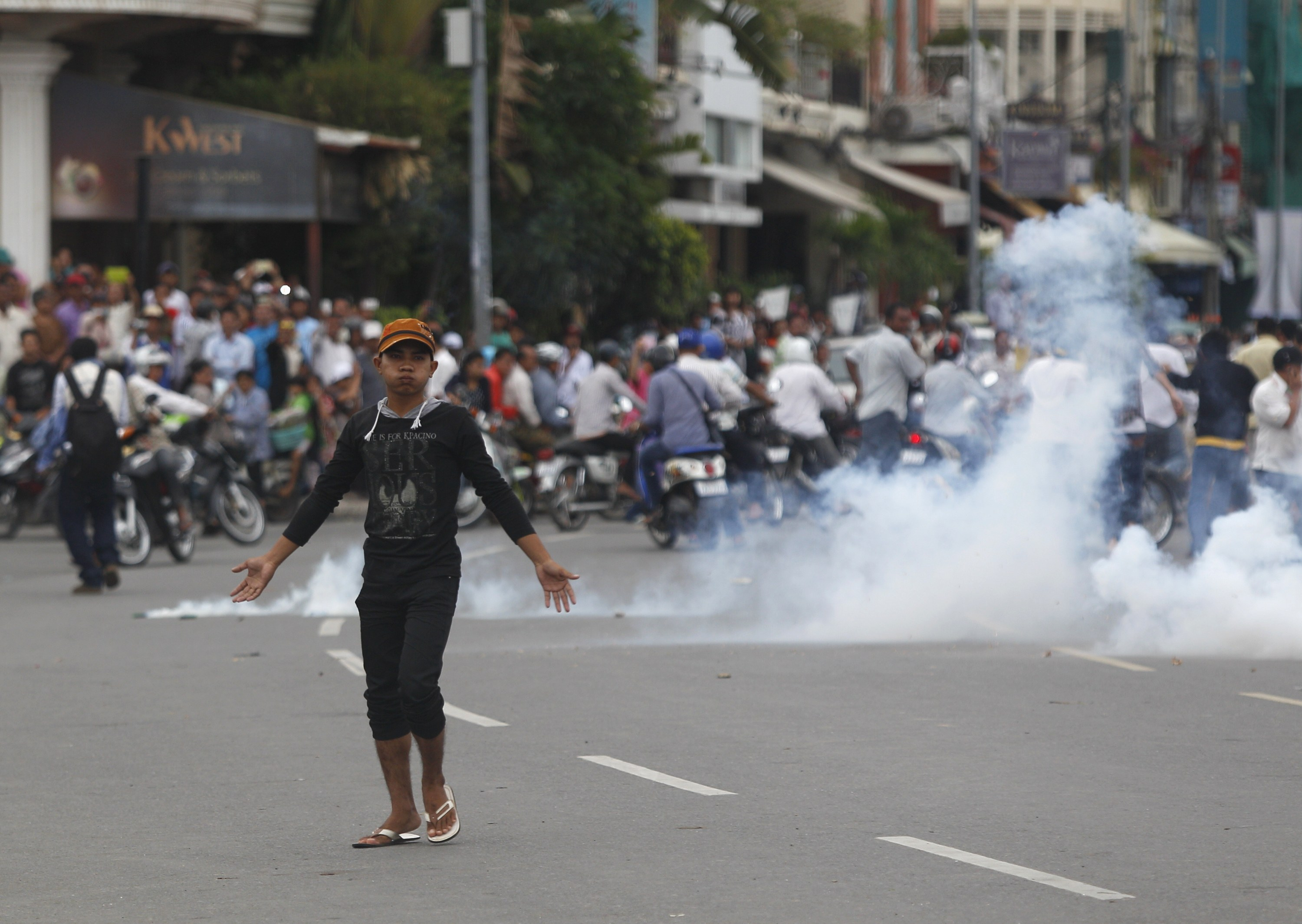 Protesters clash with police as tension rises over Cambodia