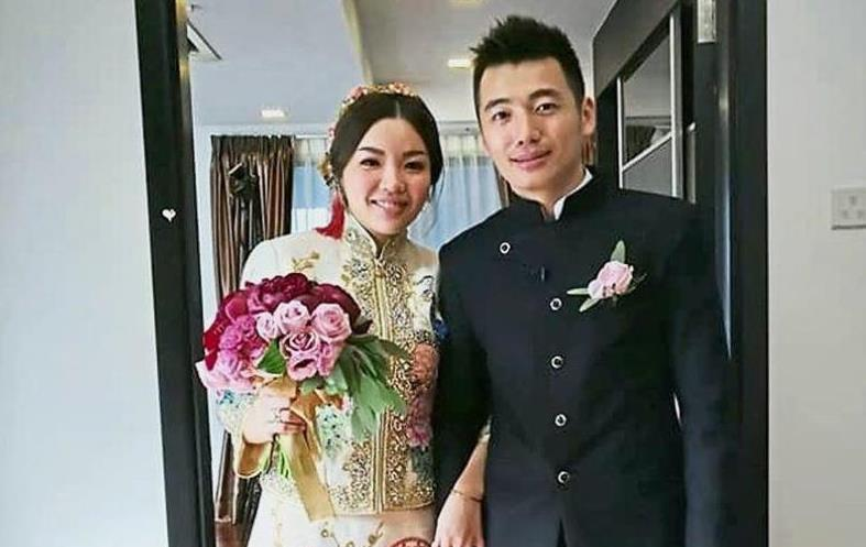 A happy man: Tan Wee Kiong (right) posing for a photograph with wife Chia Shi Ling after their wedding reception yesterday.