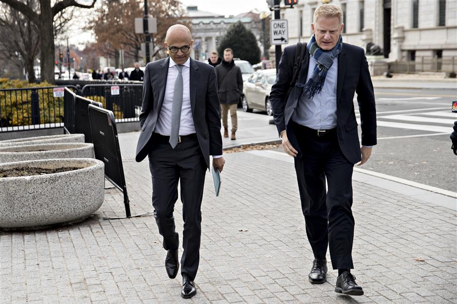 Satya Nadella, chief executive officer of Microsoft Corp., left, arrives to the White House for a meeting in Washington, D.C., U.S., on Thursday, Dec. 6, 2018. Technology industry leaders arrived to the White House for a summit to talk about emerging innovations like artificial intelligence while the effects of the administration's trade war with China loom in the background. Photographer: Andrew Harrer/Bloomberg