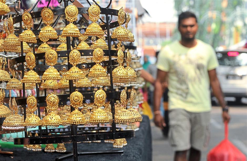 Glimmering jhumkas on display at the Deepavali bazaar at Jalan Masjid India. AZMAN GHANI / The Star