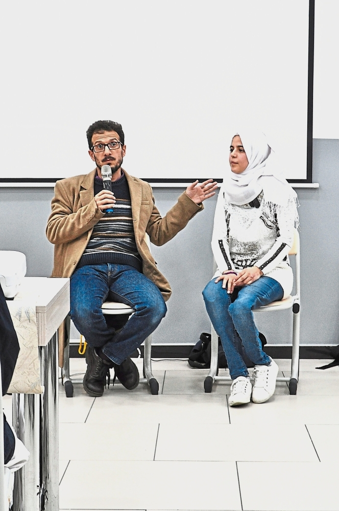 Najuah, who lost both legs below the knee in a bomb blast, sharing her story through interpreter Taleb Aldajaan, an English teacher at the El Menahil International School. Najuah is the sole survivor of a family of 11 to have escaped the horrors of the Syrian war.