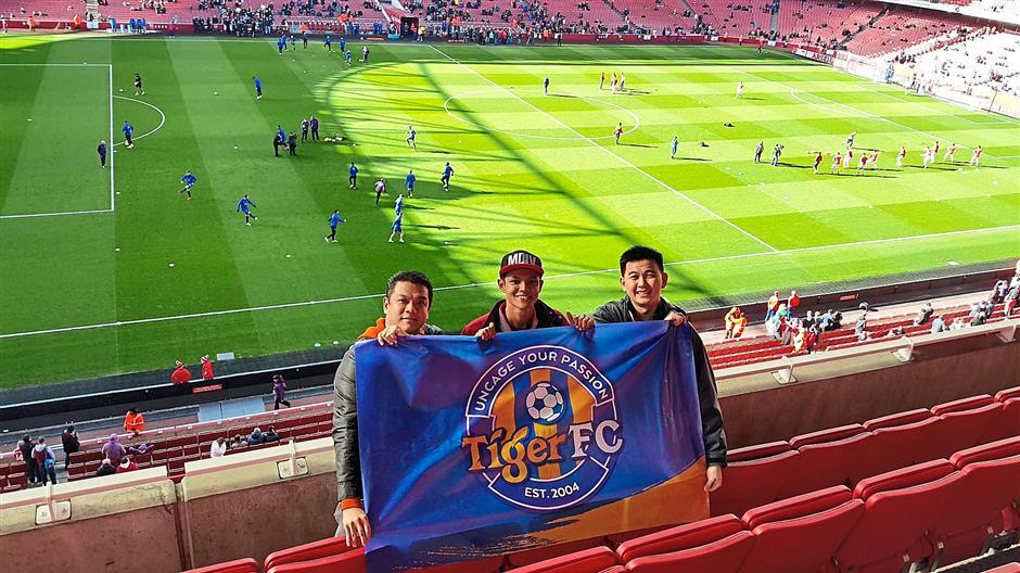 Winning trio: The boys at the Emirates stadium to watch the Arsenal vs Everton match.