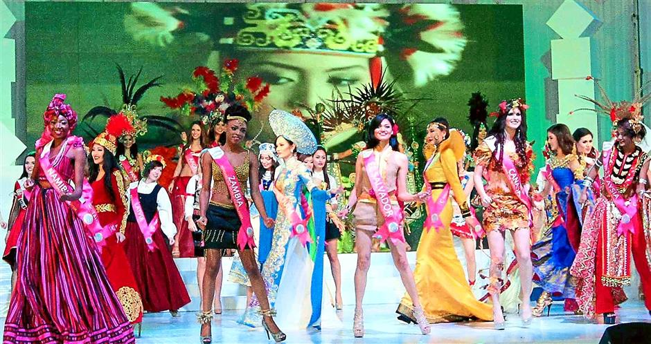 A touch of culture: All 60 delegates performing in the opening dance on stage while clad in their colourful national-themed costumes.