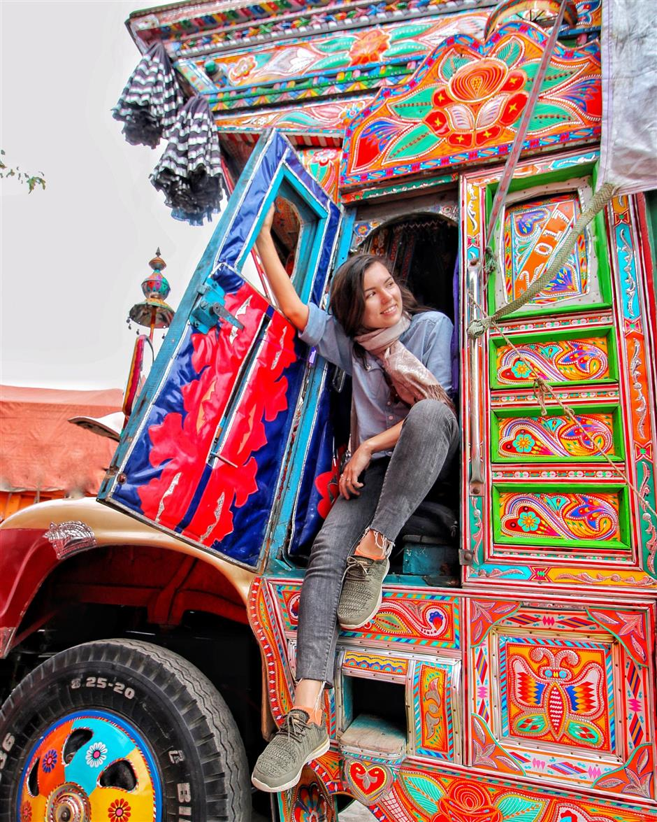 """CORRECTION - This handout picture taken on September 15, 2018, and released to AFP by Polish blogger Eva zu Beck shows zu Beck in the front seat of a decorated truck during her trip to Pakistan in Chilas, a small town in Pakistan's northern mountainous region of Gilgit, a favourite tourist spot. - They are young, Western, and full of praise for Pakistan: Travel influencers have discovered the land of the pure but critics warn their rose-tinted filters are selling an inaccurate picture of the conservative, militancy-scarred country. (Photo by HANDOUT / Eva zu Beck / AFP) / TO GO WITH: Pakistan-travel-socialmedia-influencers-security, FEATURE by Joris Fioriti -----EDITORS NOTE --- RESTRICTED TO EDITORIAL USE - MANDATORY CREDIT 'AFP PHOTO / Eva zu Beck ' - NO MARKETING - NO ADVERTISING CAMPAIGNS - DISTRIBUTED AS A SERVICE TO CLIENTS - NO ARCHIVES / """"The erroneous mention[s] appearing in the metadata of this photo by HANDOUT has been modified in AFP systems in the following manner: [ADDS HANDOUT RESTRICTIONS]. Please immediately remove the erroneous mention[s] from all your online services and delete it (them) from your servers. If you have been authorized by AFP to distribute it (them) to third parties, please ensure that the same actions are carried out by them. Failure to promptly comply with these instructions will entail liability on your part for any continued or post notification usage. Therefore we thank you very much for all your attention and prompt action. We are sorry for the inconvenience this notification may cause and remain at your disposal for any further information you may require."""""""