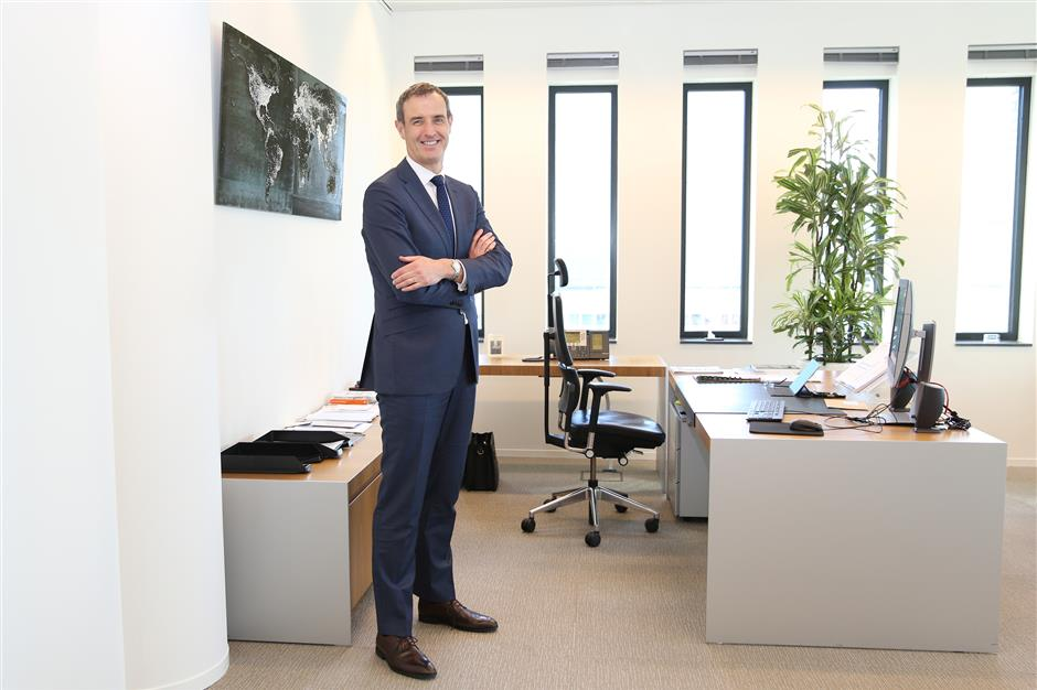 """Rob Wainwright, executive director of Europol, poses for a photograph in his office inside the European Union (EU) intelligence agency's headquarters following an interview in The Hague, Netherlands, on Tuesday, March 20, 2018. Wainwrightis leaving the EU intelligence agency he's led for almost a decade to help runDeloitte LLP's cybersecurity practice, as companies wake up to the growing """"systemic"""" threat of cyber crime. Photographer: Yuriko Nakao/Bloomberg"""