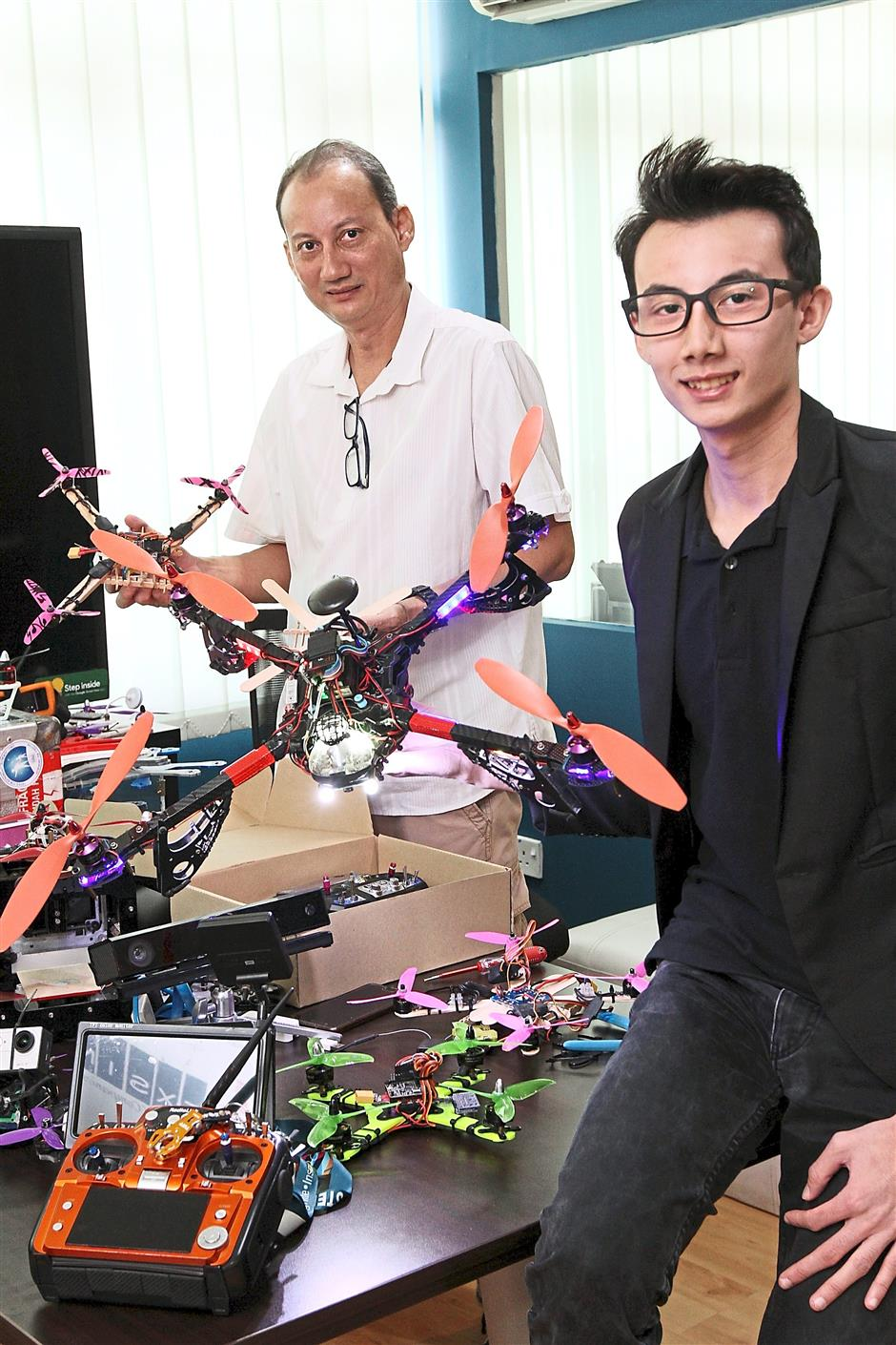 William (left) and Daryl use drones to teach kids about science and technology.
