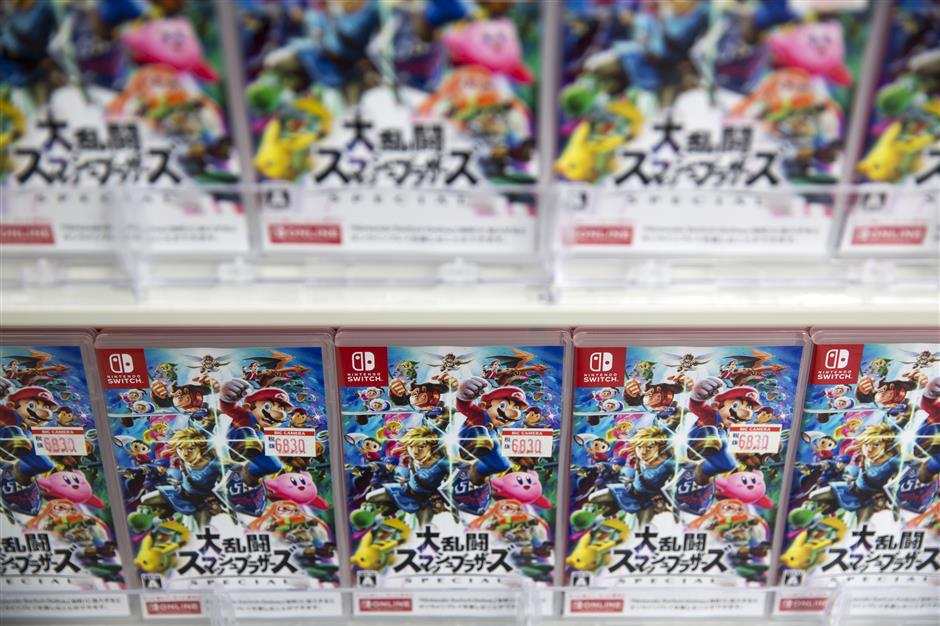 Packaged cartridges of the Nintendo Co. Super Smash Bros. Ultimate video game for Nintendo Switch are displayed at a Bic Camera Inc. electronics store in Tokyo, Japan, on Friday, Dec. 7, 2018. Investors are mostly in agreement that the game will sell well, but are watching closely if the title bolsters sales of the Switch console and helps Nintendo meet its goal of shipping 20 million units this fiscal year. Photographer: Tomohiro Ohsumi/Bloomberg