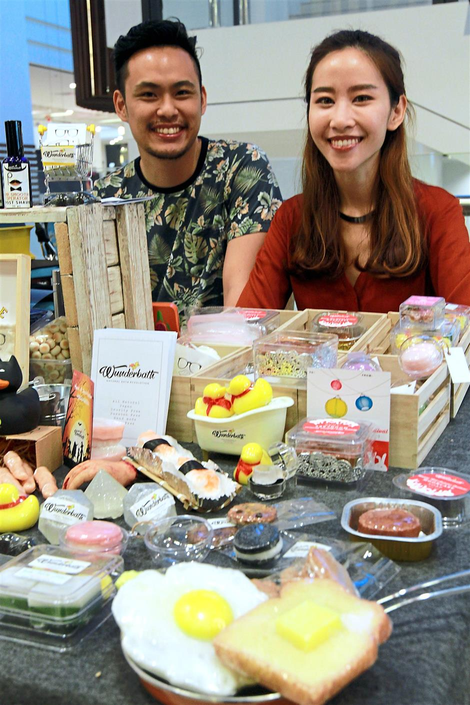 Evelyn Marieta with her husband Yong Jim showing their display of variety of soaps and lip stains