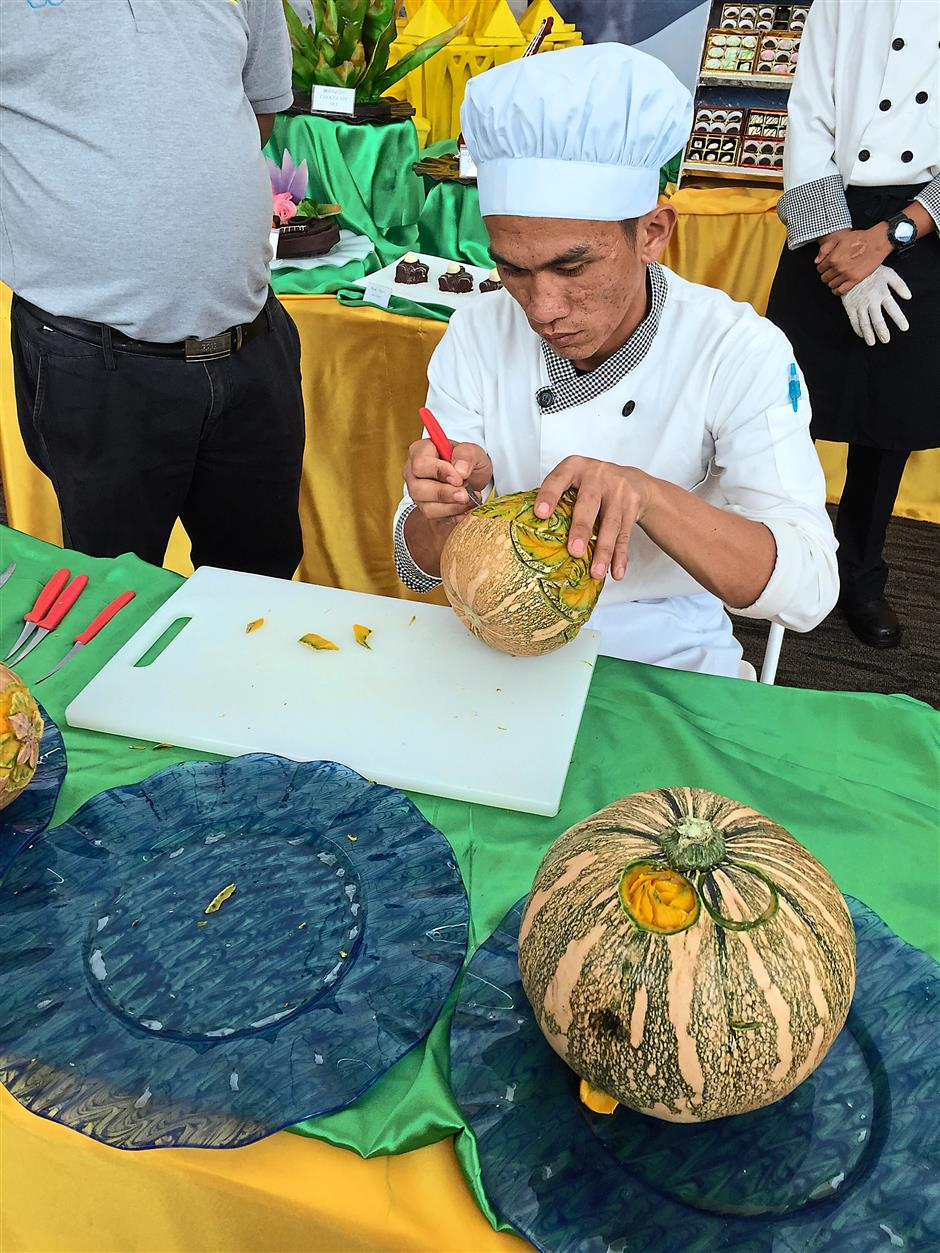 An exhibitor showing his skills of food carving.