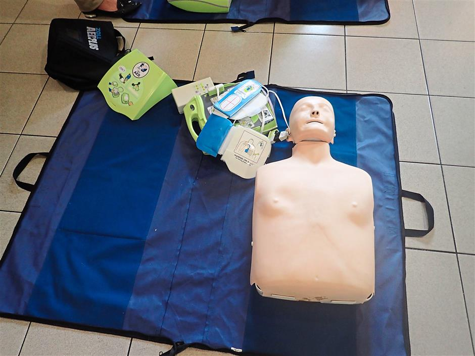 Attendees get the chance to test their newly found knowledge by practicing their CPR skills and learning how to use an AED on a dummy following the talk.