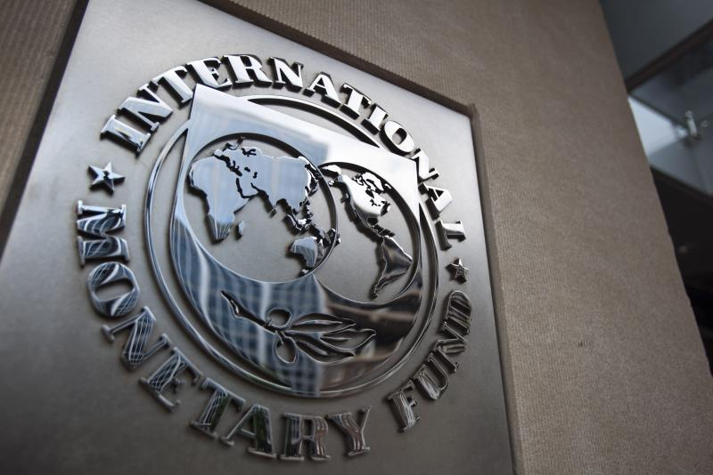The sign of the International Monetary Fund at the entrance of the Headquarters of the IMF, also known as building HQ2, in Washington, DC. Global growth is projected at 3.5% for 2015 and 3.7% for 2016, the IMF said in its latest World Economic Outlook report, lowering its forecast by 0.3 percentage points for both years - EPA Photo.