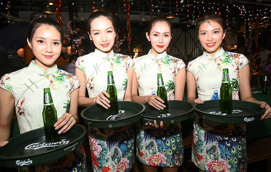 Thirst-quenchers: Carlsberg beer maidens dressed in floral cheongsam were on hand to serve guests their favourite brew.
