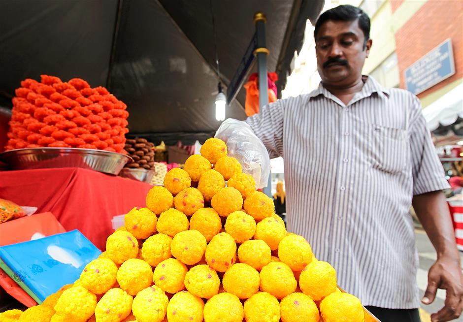 Trader Thirupathi, 45, sells home-made traditional Indian sweets at his stall in Jalan Masjid India. AZMAN GHANI / The Star