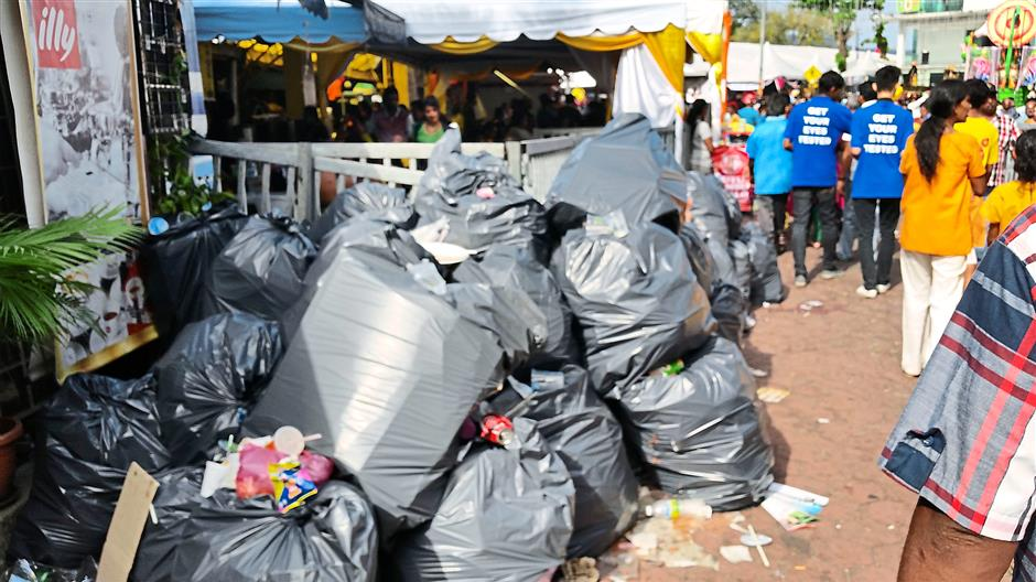 Good effort: In light of the 'Litter-Free Thaipusam 2015' campaign, the relevant authorities had made an effort to collect rubbish in a more responsible manner.
